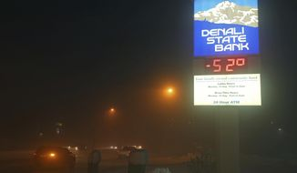 The Denali State Bank sign along Chena Pump Road in Fairbanks, Alaska, reflects the frigid temperatures that have enveloped the interior of the state Wednesday, Jan. 18, 2017. (Eric Engman/Fairbanks Daily News-Miner via AP)