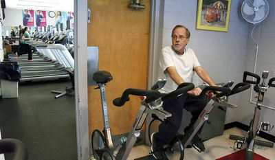 ADVANCE FOR USE SATURDAY, JAN. 21 - In this Tuesday, Jan. 10, 2017 photo, Paul McGuinness, of Avalon, Pa., a suburb of Pittsburgh, talks in Bellevue, Pa., about his double-lung transplant at Presbyterian Hospital 28 years ago. He works out at the YMCA in Bellevue and continues to defy the odds with his continued good health. (Darrell Sapp/Pittsburgh Post-Gazette via AP)