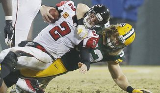 FILE - In this Dec. 8, 2014, file photo, Green Bay Packers' Clay Matthews sacks Atlanta Falcons' Matt Ryan during the second half of an NFL football game in Green Bay, Wis. The defenses will surely be tested when the Green Bay Packers meet the Atlanta Falcons in the NFC championship game. (AP Photo/Mike Roemer, File)