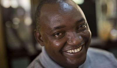 FILE- In this Saturday Dec. 3, 2016 file photo, Gambian President elect Adama Barrow sits for an interview with the Associated Press at his residence in Yundum, Gambia.  Barrow waits to take up the reins of power, as Gambian President Yahya Jammeh clings to power Wednesday Jan. 18, 2017, after more than two decades governing the west African country. (AP Photo/Jerome Delay, File)