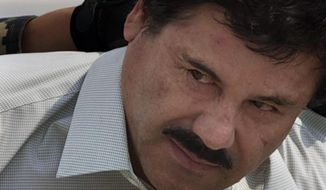 """FILE - In this Feb. 22, 2014 file photo, Joaquin """"El Chapo"""" Guzman is escorted to a helicopter in handcuffs by Mexican navy marines at a navy hanger in Mexico City. According to Mexico's Foreign Ministry, Guzman has been extradited to the United States on Thursday, Jan. 19 2017.  (AP Photo/Eduardo Verdugo, File)"""