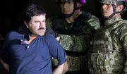 """FILE - In this Jan. 8, 2016 file photo, a handcuffed Joaquin """"El Chapo"""" Guzman is made to face the press as he is escorted to a helicopter by Mexican soldiers and marines at a federal hangar in Mexico City. According to Mexico's Foreign Ministry, Guzman has been extradited to the United States on Thursday, Jan. 19 2017.  (AP Photo/Eduardo Verdugo, File)"""