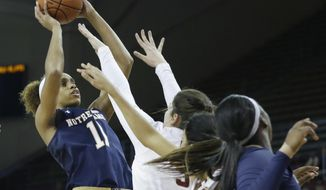 Notre Dame forward Brianna Turner (11) goes up for a shot against the defense of Boston College center Mariella Fasoula in the first half of an NCAA basketball game, Thursday, Jan.19, 2017, in Boston. (AP Photo/Elise Amendola)