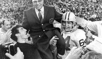 FILE - In this Jan. 14, 1968, file photo, Green Bay Packers coach Vince Lombardi is carried off the field after his team defeated the Oakland Raiders 33-14 in Super Bowl II in Miami, Fla. Packers guard Jerry Kramer (64) is at right. Talk about a mismatch. No, not on the field, where the Atlanta Falcons and the Green Bay Packers are both flying high heading into the NFC championship game. But when it comes to the tradition of these two franchises, it's no contest.  (AP Photo/File)