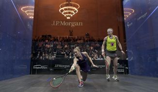 Laura Massaro, left, returns a shot from Sarah-Jane Perry during a semifinal match of the Tournament of Champions squash championship, Wednesday, Jan. 18, 2017, at Grand Central Terminal in New York. Massaro won the best of five match 3-0. (AP Photo/Julie Jacobson)
