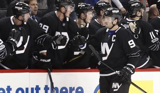 New York Islanders center John Tavares (91) is congratulated by teammates after scoring a goal against the Dallas Stars during the first period of an NHL hockey game, Thursday, Jan. 19, 2017, in New York. (AP Photo/Julie Jacobson)