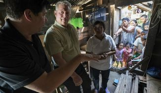 "This image released by the Sundance Institute shows Al Gore, second left, in a scene from ""An Inconvenient Sequel"" a film by Bonni Cohen and Jon Shenk. The film is an official selection of the Documentary Premieres program at the 2017 Sundance Film Festival. (Sundance Institute via AP)"