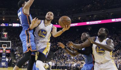 Golden State Warriors' Stephen Curry (30) drives to the basket as Oklahoma City Thunder's Andre Roberson, left, defends next to Thunder's Victor Oladipo, second from right, and Warriors' Draymond Green, right, during the first half of an NBA basketball game Wednesday, Jan. 18, 2017, in Oakland, Calif. (AP Photo/Marcio Jose Sanchez)