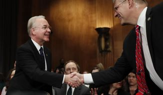 Health and Human Services Secretary-designate, Rep. Tom Price, R-Ga., left, is greeted on Capitol Hill in Washington, Wednesday, Jan. 18, 2017, by Rep. Barry Loudermilk, R-Ga., prior to testifying at this confirmation hearing before the Senate Health, Education, Labor and Pensions Committee. (AP Photo/Carolyn Kaster)