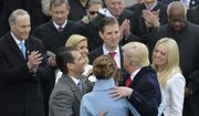 President Donald Trump hugs his family after taking the oath of office during the 58th Presidential Inauguration at the U.S. Capitol in Washington, Friday, Jan. 20, 2017. (AP Photo/Susan Walsh)