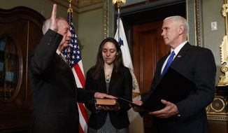 Vice President Mike Pence administers the oath of office the Defense Secretary James Mattis, Friday, Jan. 20, 2017, in the Vice Presidential Ceremonial Office in the Eisenhower Executive Office building on the White House grounds in Washington. (AP Photo/Evan Vucci)
