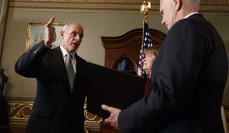 Vice President Mike Pence administers the oath of office to Homeland Security Secretary John Kelly in the Vice Presidential Ceremonial Office in the Eisenhower Executive Office building on the White House grounds in Washington, Friday, Jan. 20, 2017. (AP Photo/Evan Vucci)