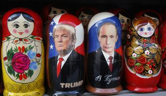 Traditional Russian wooden dolls called Matryoshka depicting Russian President Vladimir Putin and Donald Trump, hours before Donald Trump is to be sworn in as president of the United States, are displayed for sale at a street souvenir shop in St. Petersburg, Russia, Friday, Jan. 20, 2017. (AP Photo/Dmitri Lovetsky)