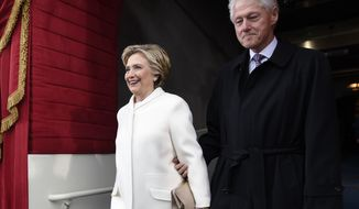 Former President Bill Clinton and his wife Hillary Clinton arrive on Capitol Hill in Washington, Friday, Jan. 20, 2017, for the presidential inauguration of Donald Trump. (Saul Loeb via AP, Pool)