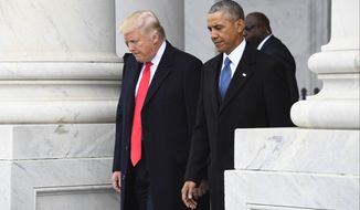 President Donald Trump walks with former President Barack Obama on Capitol Hill in Washington, Friday, Jan. 20, 2017, prior to Obama's departure from the 2017 Presidential Inauguration. (Jack Gruber/Pool Photo via AP)