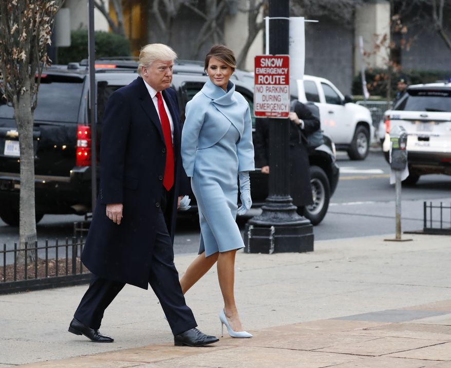 President-elect Donald Trump and his wife Melania arrives for a church service at St. Johns Episcopal Church across from the White House in Washington, Friday, Jan. 20, 2017, on Donald Trump's inauguration day. (AP Photo/Alex Brandon)