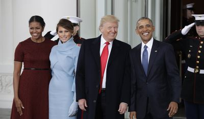President Barack Obama stands with President-elect Donald Trump, first lady Michelle Obama and Melania Trump at the White House in Washington, Friday, Jan. 20, 2017 (AP Photo/Evan Vucci)