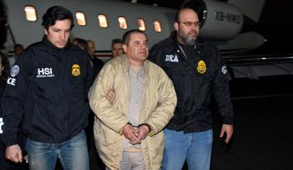 """In this photo provided U.S. law enforcement, authorities escort Joaquin """"El Chapo"""" Guzman, center, from a plane to a waiting caravan of SUVs at Long Island MacArthur Airport on Thursday, Jan. 19, 2017, in Ronkonkoma, N.Y. The infamous drug kingpin who twice escaped from maximum-security prisons in Mexico was extradited at the request of the U.S. to face drug trafficking and other charges, and landed in New York late Thursday, a federal law enforcement official said. (U.S. law enforcement via AP)"""