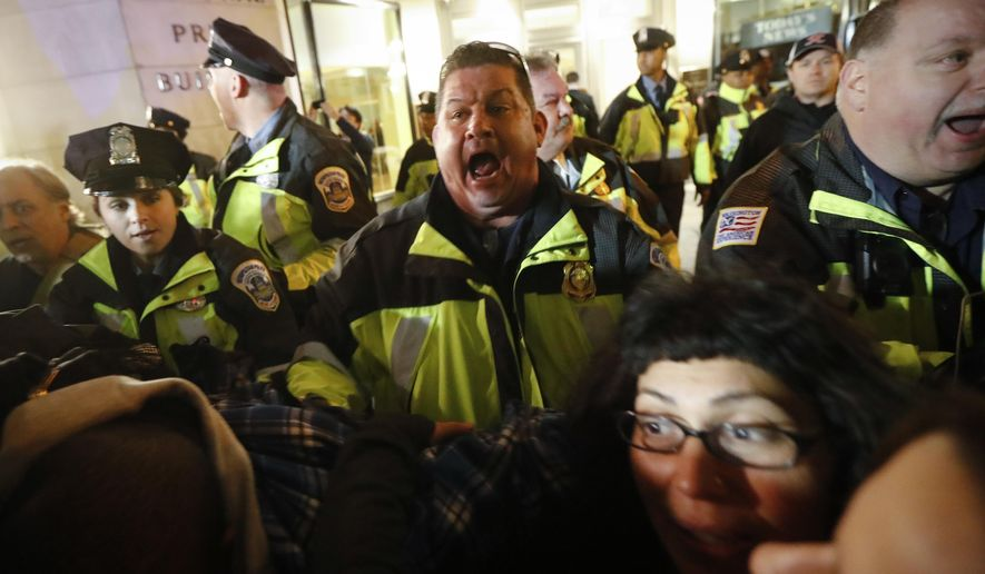 A police officer yells for protesters to step off the for A step ahead salon poughkeepsie ny