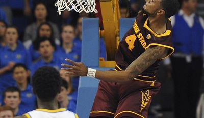 Arizona State forward Torian Graham (4) goes for a dunk against UCLA during the second half of an NCAA college basketball game in Los Angeles, Thursday, Jan. 19, 2017. UCLA won 102-80. (AP Photo/Michael Owen Baker)