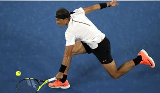 Spain's Rafael Nadal makes a backhand return to Marcos Baghdatis of Cyprus during their second round match at the Australian Open tennis championships in Melbourne, Australia, Thursday, Jan. 19, 2017. (AP Photo/Dita Alangkara)