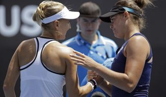 United States' Jennifer Brady, right, is congratulated by Russia's Elena Vesnina after winning their third round match at the Australian Open tennis championships in Melbourne, Australia, Saturday, Jan. 21, 2017. (AP Photo/Dita Alangkara)