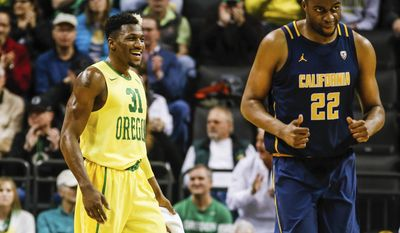 Oregon guard Dylan Ennis (31), reacts as California center Kingsley Okoroh (22) heads down court, in an NCAA college basketball game Thursday, Jan. 19, 2017, in Eugene, Ore. (AP Photo/Thomas Boyd)