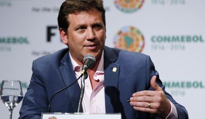 FILE - This is a March 28, 2016, file photo, showing CONMEBOL President Alejandro Dominguez speaksing during a press conference at the CONMEBOL Convention Center in Luque, Paraguay. FIFA has appointed the president of the corruption-ravaged South American governing body to chair its finance committee. Alejandro Dominguez of Paraguay will lead the new eight-member panel, which includes two independent officials from outside soccer, FIFA said on Friday, Jan. 20, 2017. (AP Photo/Jorge Saenz, File)
