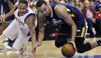 Utah Jazz forward Trey Lyles, right, gets to the ball in front of Dallas Mavericks guard Devin Harris during the first half of an NBA basketball game in Dallas, Friday, Jan. 20, 2017. (AP Photo/LM Otero)