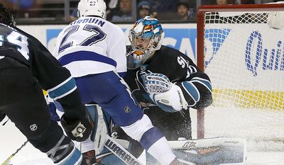 Tampa Bay Lightning left wing Jonathan Drouin (27) scores a goal past San Jose Sharks goalie Aaron Dell (30) during the second period of an NHL hockey game, Thursday, Jan. 19, 2017, in San Jose, Calif. (AP Photo/Tony Avelar)