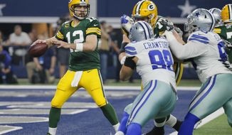FILE -  In this Sunday, Jan. 15, 2017 file photo, Green Bay Packers' Aaron Rodgers throws during the first half of an NFL divisional playoff football game against the Dallas Cowboys in Arlington, Texas. The Green Bay Packers play the Atlanta Falcons in the NFC championship game, Sunday, Jan. 22, 2017. (AP Photo/Tony Gutierrez, File)