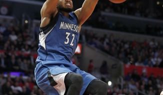 Minnesota Timberwolves center Karl-Anthony Towns dunks during the second half of the team's NBA basketball game against the Los Angeles Clippers, Thursday, Jan. 19, 2017, in Los Angeles. The Timberwolves won 104-101. (AP Photo/Ryan Kang)