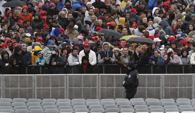 A Capitol Hill police officer watches the crowd before the swearing in of Donald Trump as the 45th president of the United States during the 58th Presidential Inauguration at the U.S. Capitol in Washington. Friday, Jan. 20, 2017 (AP Photo/Andrew Harnik)