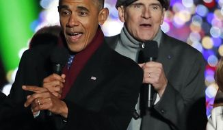"FILE - In this Dec. 1, 2016 file photo, President Barack Obama sings ""Jingle Bells"" with James Taylor and others during the lighting ceremony for the 2016 National Christmas Tree on the Ellipse near the White House in Washington. Taylor, on vacation in French Polynesia, posted a video online Friday, Jan. 20, 2017, bemoaning the end of the Obama era, saying, ""Hi, it's James on the last day of the Obama administration, and it feels like it's raining all over the world."" (AP Photo/Alex Brandon)"
