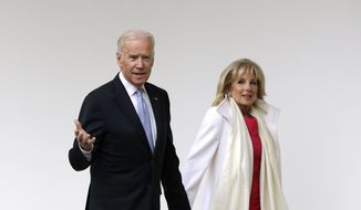 Vice President Joe Biden and his wife Jill walk along the colonnades of the White House in Washington, Friday, Jan. 20, 2017, before the start of presidential inaugural festivities for the incoming 45th President of the United States Donald Trump. (AP Photo/Evan Vucci)