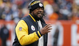 FILE - In a Sunday, Nov. 20, 2016 file photo, Pittsburgh Steelers head coach Mike Tomlin yells at an official during the first half of an NFL football game against the Cleveland Browns in Cleveland. If you're wondering what the Falcons are doing in the NFL's version of the Final Four with the Patriots, Steelers and Packers, you aren't alone. The Steelers  enter the game with the knowledge that they haven't lost since Nov. 13 and are relatively healthy. (AP Photo/Ron Schwane, File)