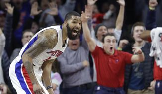 Detroit Pistons forward Marcus Morris and fans react after Morris' game-winning tip=in during the second half of the team's NBA basketball game against the Washington Wizards, Saturday, Jan. 21, 2017, in Auburn Hills, Mich. Detroit defeated Washington 113-112. (AP Photo/Carlos Osorio)