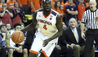 Virginia guard Marial Shayok (4) dribbles during the first half of an NCAA college basketball game on Saturday, Jan. 21, 2017 in Charlottesville, Va. Virginia defeated Georgia Tech 62-49. (AP Photo/Ryan M. Kelly)