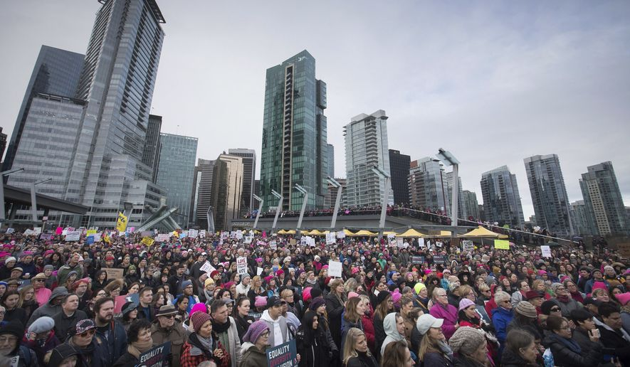 Thousands of people gather for a women's march and protest against U.S. President Donald Trump, in Vancouver, British Columbia on Saturday Jan. 21, 2017. Protests are being held across Canada today in support of the Women's March on Washington.   (Darryl Dyck/The Canadian Press via AP)
