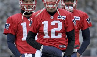 New England Patriots quarterbacks Tom Brady (12). Jimmy Garoppolo, left, and Jacoby Brissett warm up for the NFL football team's practice Friday, Jan. 20, 2017, in Foxborough, Mass. The Patriots take on the Pittsburgh Steelers in the AFC championship game Sunday night. (Mark Stockwell/The Sun Chronicle via AP)