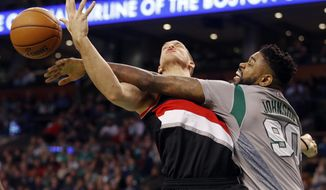 Boston Celtics forward Amir Johnson (90) battles Portland Trail Blazers center Mason Plumlee for a rebound during the second quarter of an NBA basketball game in Boston, Saturday, Jan. 21, 2017. (AP Photo/Winslow Townson)