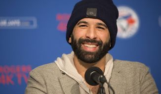 Toronto Blue Jays' Jose Bautista speaks to the media about re-signing with the club during a baseball press conference in Toronto on Saturday, Jan. 21, 2017. (Chris Young/The Canadian Press via AP)