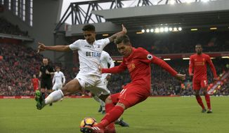 Swansea City's Kyle Naughton,left, and Liverpool's Roberto Firmino battle for the ball during the English Premier League soccer match between Liverpool and Swansea City at Anfield, Liverpool, England, Saturday, Jan. 21, 2017. (Peter Byrne/PA via AP)