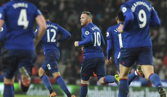 Manchester United's Wayne Rooney, centre, celebrates after scoring from a free kick during the English Premier League soccer match between Stoke City and Manchester United at the Britannia Stadium, Stoke on Trent, England, Saturday, Jan. 21, 2017. (AP Photo/Rui Vieira)