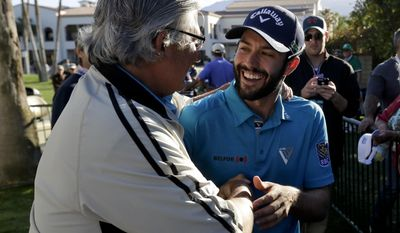 Adam Hadwin, right, is greeted by amateur Dominic Curio after Hadwin shot a 59 and took the third round lead in the CareerBuilder Challenge golf tournament at La Quinta Country Club, Saturday, Jan. 21, 2017, in La Quinta, Calif. (AP Photo/Chris Carlson)