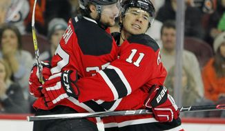 New Jersey Devils' Pavel Zacha, left, celebrates his goal with PA Parenteau during the first period of an NHL hockey game against the Philadelphia Flyers, Saturday, Jan. 21, 2017, in Philadelphia. (AP Photo/Tom Mihalek)