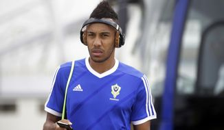 Gabon's Pierre Emerick Aubameyang arrives for a training session at the Stade de l'Amitie, Libreville, Gabon, Saturday, Jan. 21, 2017, ahead of their African Cup of Nations Group A soccer match against Cameroon. (AP Photo/Sunday Alamba)