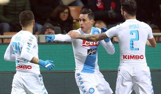 Napoli's Jose' Maria Callejon, center, celebrates with his teammates after scoring during a Serie A soccer match between AC Milan and Napoli at Giuseppe Meazza stadium, in Milan, Italy, Saturday, Jan. 21, 2017. (Matteo Bazzi/ANSA via AP)