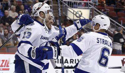 Tampa Bay Lightning center Cedric Paquette (13) celebrates his goal against the Arizona Coyotes with defenseman Anton Stralman (6) and center Gabriel Dumont during the first period of an NHL hockey game Saturday, Jan. 21, 2017, in Glendale, Ariz. (AP Photo/Ross D. Franklin)