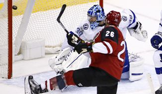 Arizona Coyotes defenseman Michael Stone (26) scores a goal against Tampa Bay Lightning goalie Ben Bishop (30 during the second period of an NHL hockey game Saturday, Jan. 21, 2017, in Glendale, Ariz. (AP Photo/Ross D. Franklin)